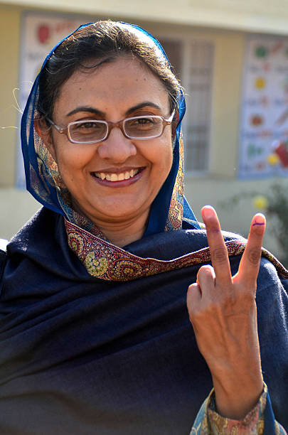Hargeet Kaur wife of Congress candidate from Lambi Maheshinder Singh Badal gestures after casting her vote at the polling booth in the Badal Village..