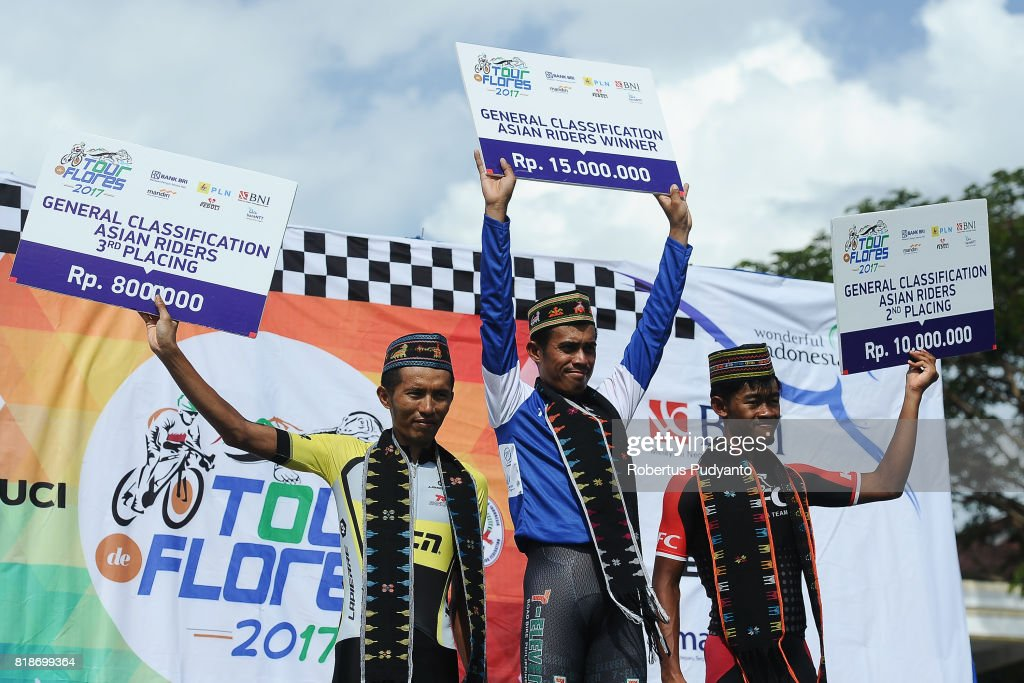 Hari Fitrianto of CCN Cycling Team Laos, Marcelo Felipe of 7 Eleven Cycling Team Philippines, and Muh. Imam Arifin of KFC Cycling Team Indonesia celebrate on the podium during Best South East Asia Riders awarding ceremony of the Tour de Flores 2017 on July 19, 2017 in Labuan Bajo, Flores, Indonesia.
