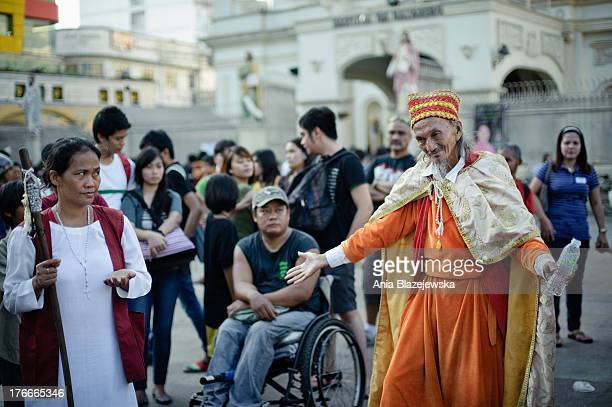CONTENT] Hari Krisong a former actor who claims to be Jesus Christ baptising a new follower on Plaza Miranda in Quiapo