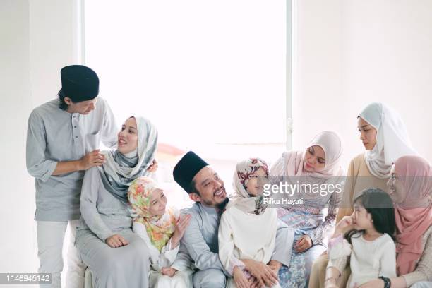 hari raya celebration with family - eid ul fitr stock pictures, royalty-free photos & images