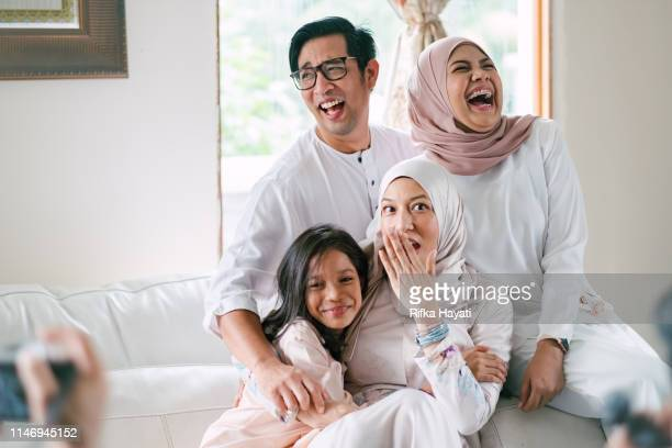hari raya celebration with family - malaysian culture stock pictures, royalty-free photos & images