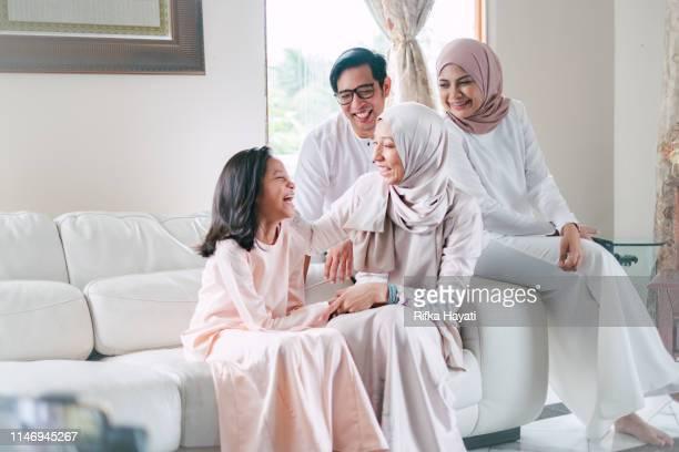 hari raya celebration with family - hari raya celebration stock pictures, royalty-free photos & images