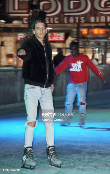 Hari Tahov and Shaka Smith attend Media And VIP Night Queen Mary Christmas held at The Queen Mary on December 6 2019 in Long Beach California