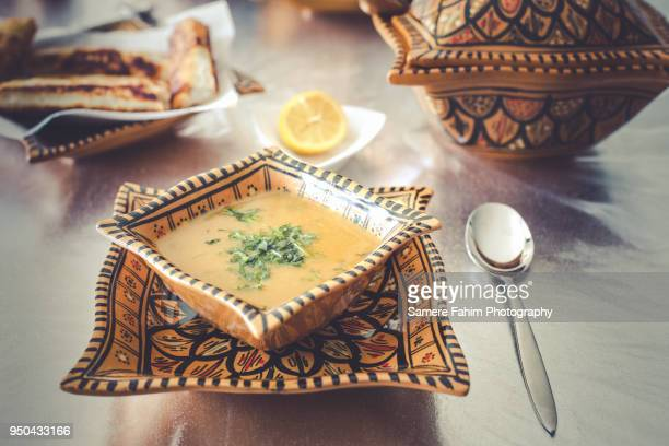 harira soup served on bowl with bourak (brik) - moroccan culture stock photos and pictures