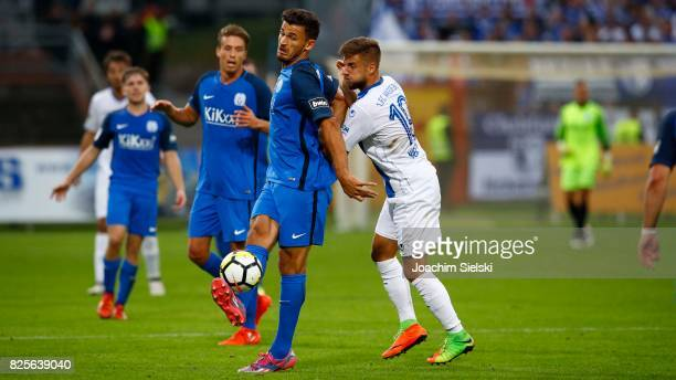 Haris Hyseni of Meppen challenges Michel Niemeyer of Magdeburg during the 3 Liga match between SV Meppen and 1 FC Magdeburg at Haensch Arena on...