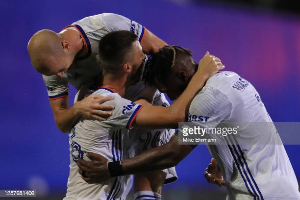 Haris Medunjanin of FC Cincinnati and teammates celebrate an own goal scored by Florian Valot of New York Red Bulls during a match as part of MLS Is...