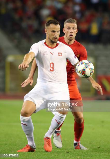 Haris Seferovic and Toby Alderweireld fight for the ball during the UEFA Nations League A group two match between Belgium and Switzerland at King...