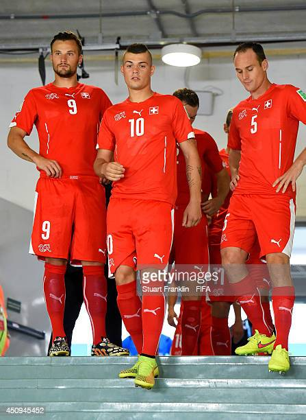 Haris Seferovic Granit Xhaka and Steve von Bergen of Switzerland look on in the tunnel prior to the 2014 FIFA World Cup Brazil Group E match between...