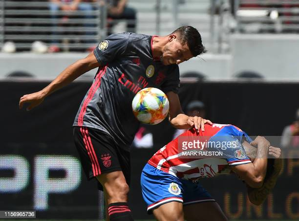Haris Seferovic of Benfica clashes with Alexis Vega of Chivas de Guadalajara during their 2019 International Champions Cup match at the Levi's...