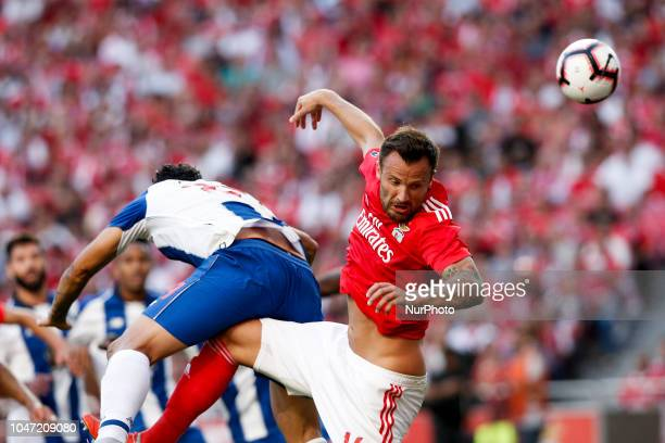 Haris Seferovic of Benfica heads for the ball with Tiquinho Soares of Porto during the Portuguese League football match between SL Benfica and FC...
