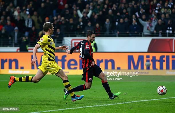 Haris Seferovic of Eintracht Frankfurt scores their second goal past Matthias Ginter of Borussia Dortmund during the Bundesliga match between...