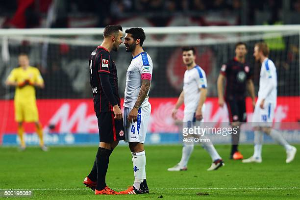 Haris Seferovic of Frankfurt and Aytac Sulu of Darmstadt stand face to face during the Bundesliga match between Eintracht Frankfurt and SV Darmstadt...