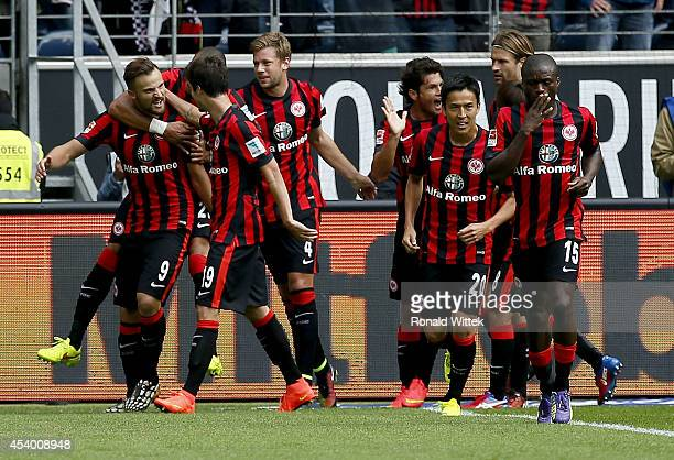 Haris Seferovic of Frankfurt celebrates with his teammates after scoring his team's first goal during the Bundesliga match between Eintracht...