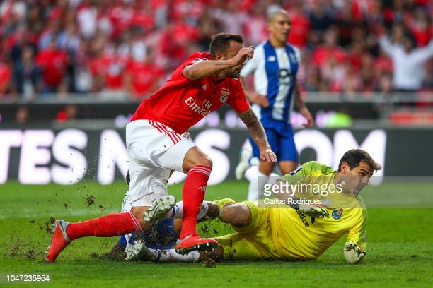 Haris Seferovic of SL Benfica beats Iker Casillas of FC Porto and scores SL Benfica goal during the Liga NOS round 7 match between SL Benfica and FC...