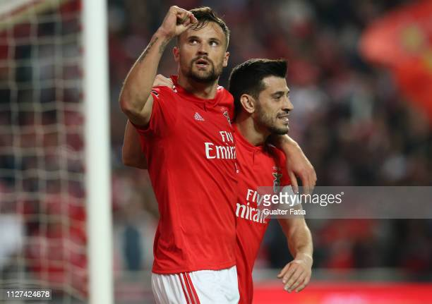 Haris Seferovic of SL Benfica celebrates with teammate Pizzi of SL Benfica after scoring a goal during the Liga NOS match between SL Benfica and GD...