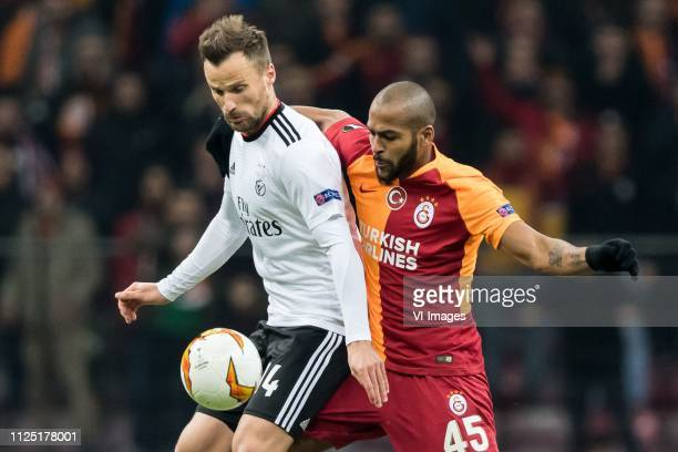 Haris Seferovic of SL Benfica Marcos do Nascimento Teixeira of Galatasaray SK during the UEFA Europa League round of 32 match between Galatasaray SK...