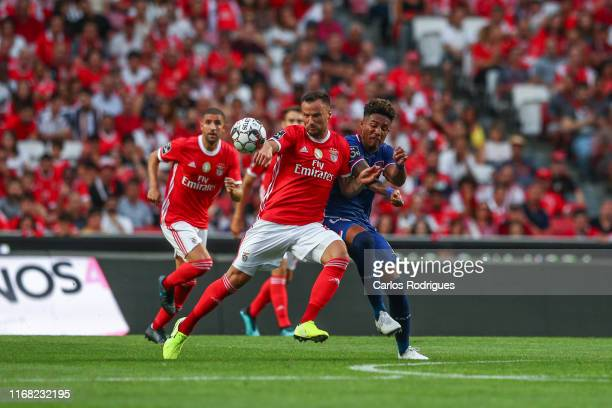 Haris Seferovic of SL Benfica vies with Ygor Nogueira of Gil Vicente FC during the Liga NOS round five match between SL Benfica and Gil Vicente FC at...