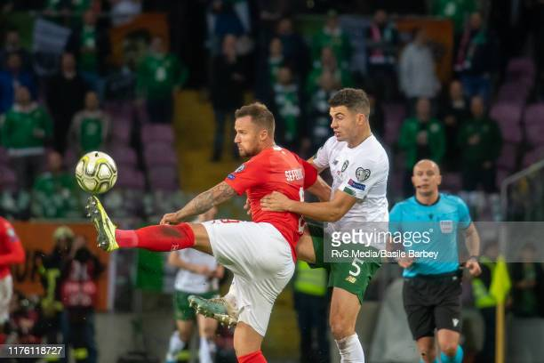 Haris Seferovic of Switzerland battles for the ball with John Egan of Republic of Ireland during the UEFA Euro 2020 qualifier between Switzerland and...