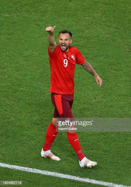 Haris Seferovic of Switzerland celebrates after scoring their team's first goal during the UEFA Euro 2020 Championship Group A match between...