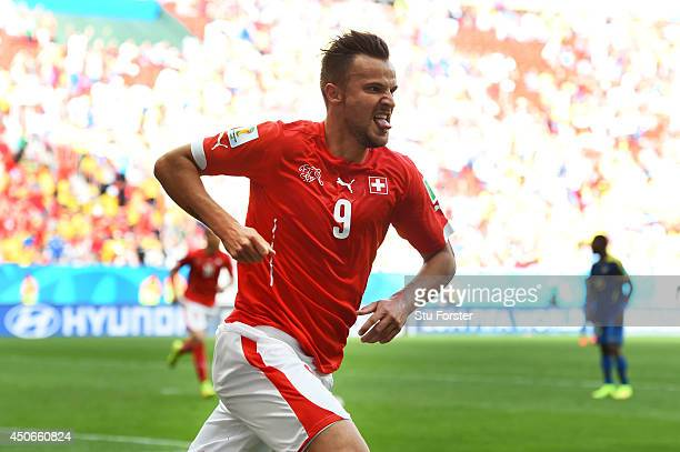 Haris Seferovic of Switzerland celebrates scoring his team's second goal during the 2014 FIFA World Cup Brazil Group E match between Switzerland and...