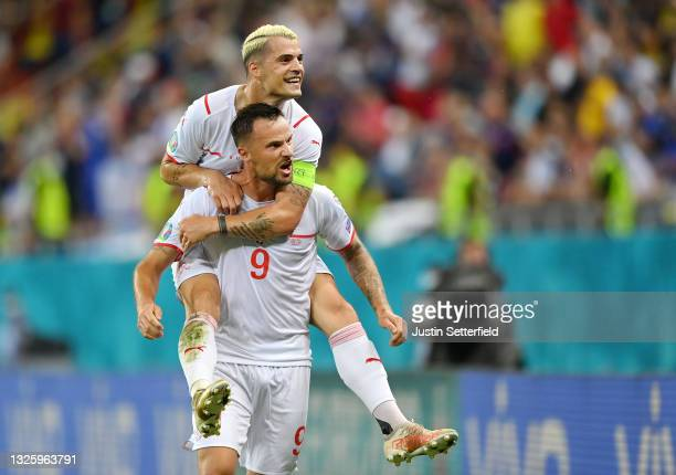 Haris Seferovic of Switzerland celebrates with Granit Xhaka after scoring their side's first goal during the UEFA Euro 2020 Championship Round of 16...