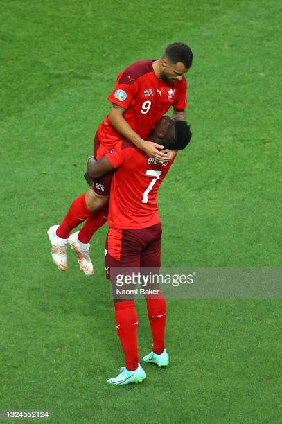 Haris Seferovic of Switzerland celebrates with teammate Breel Embolo after scoring their team's first goal during the UEFA Euro 2020 Championship...