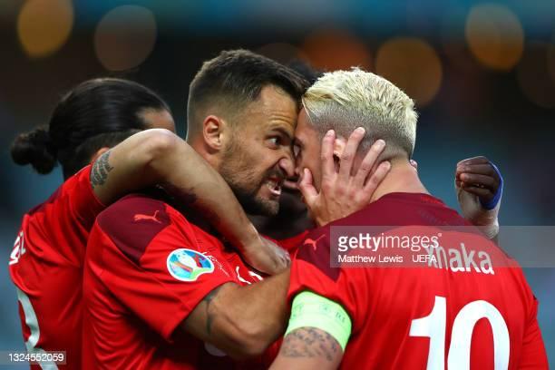 Haris Seferovic of Switzerland celebrates with teammate Granit Xhaka after scoring their team's first goal during the UEFA Euro 2020 Championship...
