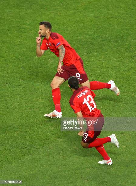 Haris Seferovic of Switzerland celebrates with teammate Ricardo Rodriguez after scoring their team's first goal during the UEFA Euro 2020...