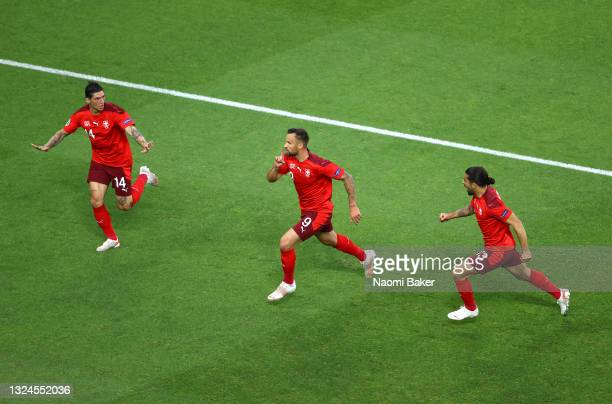 Haris Seferovic of Switzerland celebrates with teammates Steven Zuber and Ricardo Rodriguez after scoring their team's first goal during the UEFA...