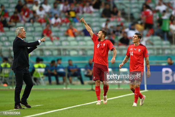 Haris Seferovic of Switzerland celebrates with Vladimir Petkovic, Head Coach of Switzerland after scoring his team's first goal during the UEFA Euro...