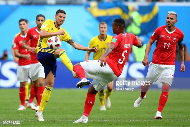 Haris Seferovic of Switzerland competes for the ball with Manuel Akanji of Switzerland during the 2018 FIFA World Cup Russia Round of 16 match...