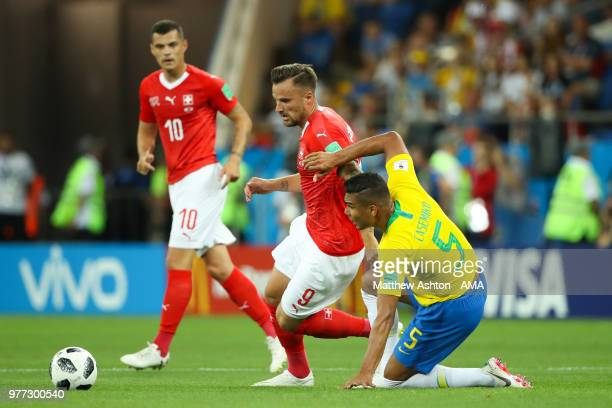 Haris Seferovic of Switzerland competes with Casemiro of Brazil during the 2018 FIFA World Cup Russia group E match between Brazil and Switzerland at...
