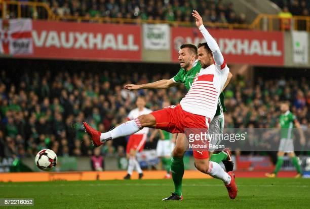Haris Seferovic of Switzerland holds off Gareth McAuley of Northern Ireland during the FIFA 2018 World Cup Qualifier PlayOff First Leg between...