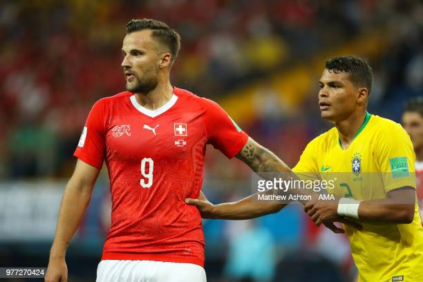 Haris Seferovic of Switzerland holds off Thiago Silva of Brazil during the 2018 FIFA World Cup Russia group E match between Brazil and Switzerland at...