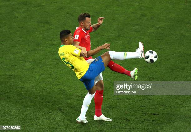Haris Seferovic of Switzerland is challenged by Casemiro of Brazil during the 2018 FIFA World Cup Russia group E match between Brazil and Switzerland...