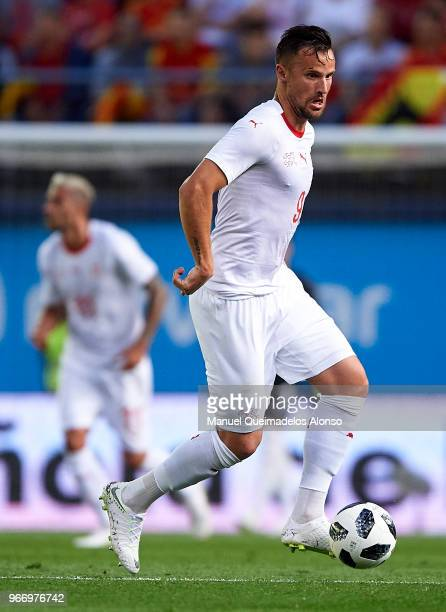 Haris Seferovic of Switzerland runs with the ball during the International Friendly match between Spain and Switzerland at Estadio de La Ceramica on...