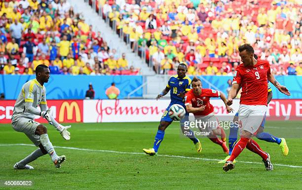 Haris Seferovic of Switzerland scores his team's second goal past Alexander Dominguez of Ecuador during the 2014 FIFA World Cup Brazil Group E match...