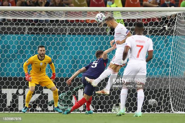 Haris Seferovic of Switzerland scores their side's first goal past Hugo Lloris of France during the UEFA Euro 2020 Championship Round of 16 match...
