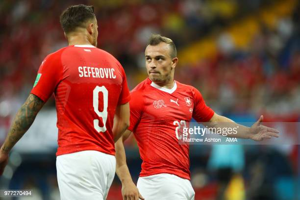 Haris Seferovic of Switzerland speaks to Xherdan Shaqiri of Switzerland during the 2018 FIFA World Cup Russia group E match between Brazil and...