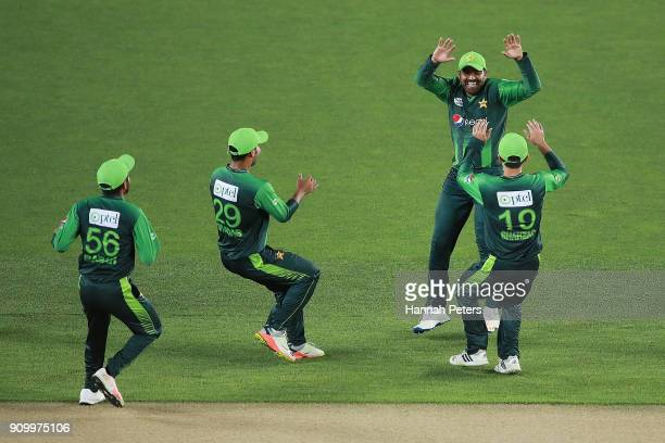 Haris Sohail of Pakistan celebrates with his team after claiming the wicket of Kane Williamson of the Black Caps during the International Twenty20...