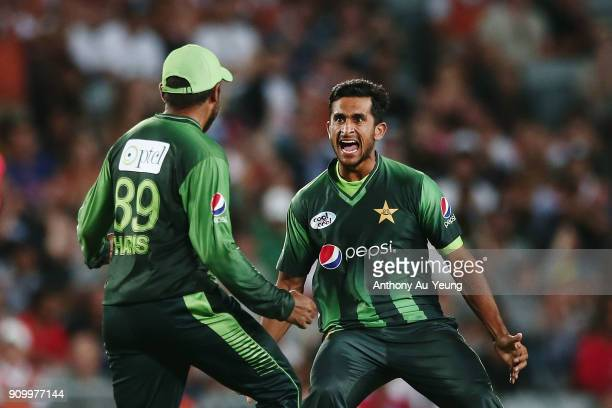 Haris Sohail of Pakistan celebrates with teammate Hasan Ali for the wicket of Tom Bruce of New Zealand during the International Twenty20 match...