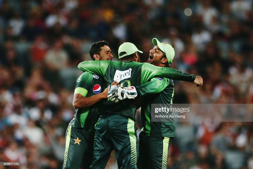 Haris Sohail of Pakistan celebrates with teammates Hasan Ali and Sarfraz Ahmed for the wicket of Tom Bruce of New Zealand during the International Twenty20 match between New Zealand and Pakistan at Eden Park on January 25, 2018 in Auckland, New Zealand.