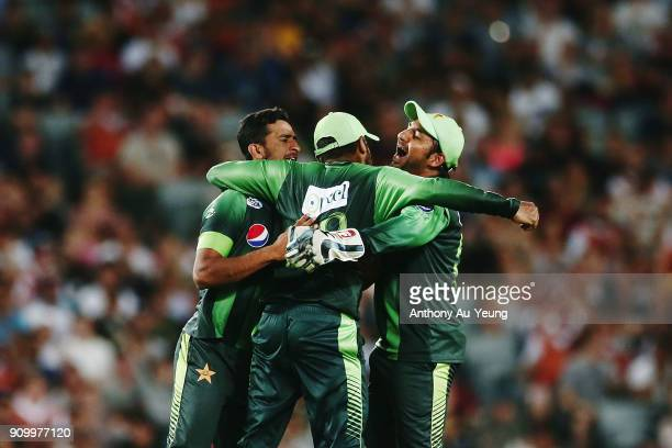 Haris Sohail of Pakistan celebrates with teammates Hasan Ali and Sarfraz Ahmed for the wicket of Tom Bruce of New Zealand during the International...