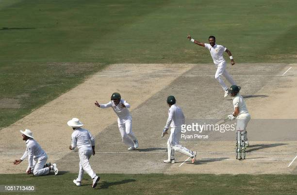 Haris Sohail of Pakistan takes a catch to dismiss Travis Head of Australia off the bowling Bilal Asif of Pakistan of during day three of the First...