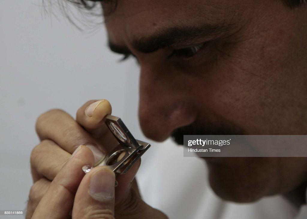 Harish Sojitra, Secretary of Diamond Manufacturers' Owners' Association while checking a diamond.