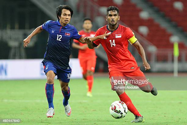 Hariss Harun of Singapore dribbles past Sos Suhana of Camboda during the 2018 FIFA World Cup Qualifier Group E Match between Singapore and Cambodia...