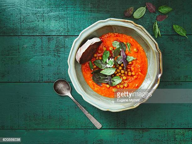 harissa soup with potato and chickpeas - tomato soup stock photos and pictures