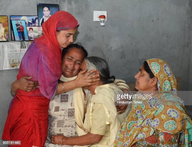 Harjit Kaur with motherinlaw Joginder Kaur grieving the death of his husband Gurcharan Singh who was killed in Iraq at Jalal Usma Village on March 20...
