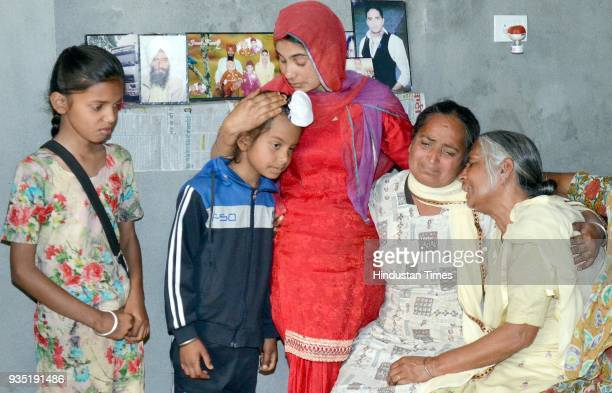 Harjit Kaur with Navdeep Kaur daughter and Amanjot Singh son and motherinlaw Joginder Kaur grieving the death of his husband Gurcharan Singh who was...