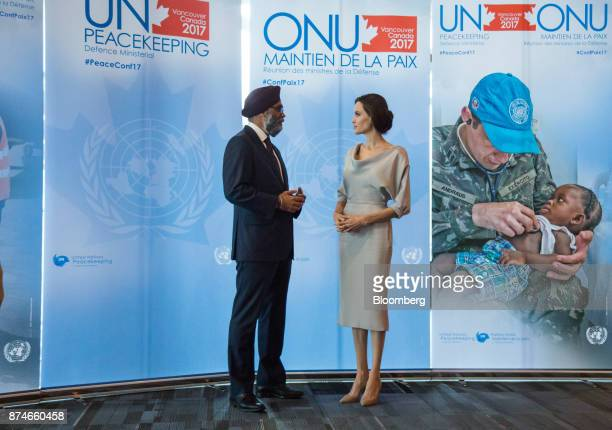 Harjit Sajjan Canada's defense minister left speaks with actress Angelina Jolie special envoy to the United Nations High Commissioner for Refugees...
